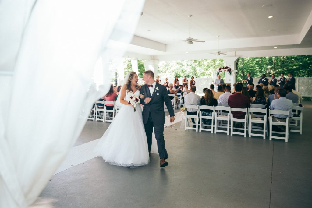 groom and bride walk down after being married